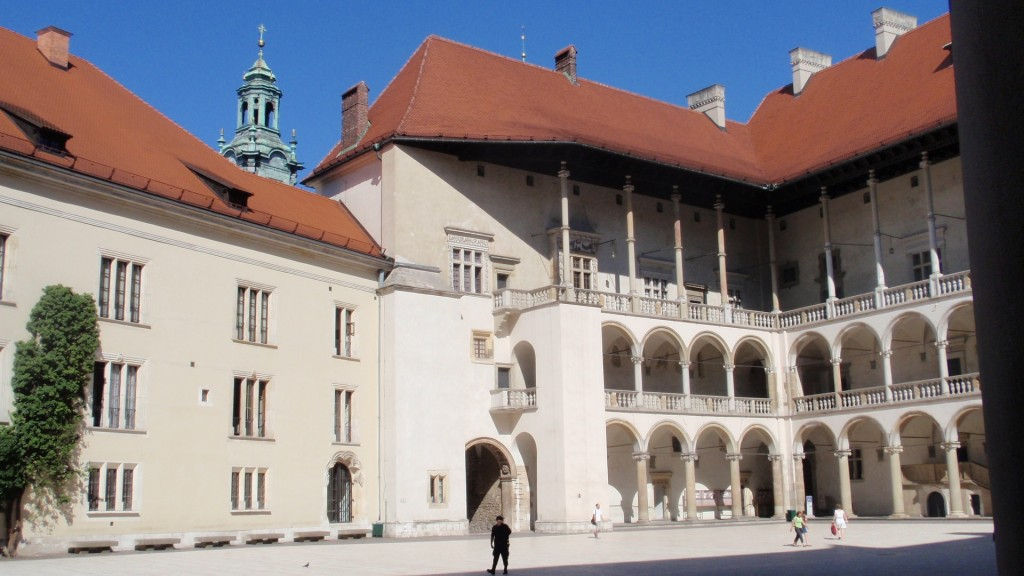 Wawel courtyard. The location of the chakra stone is believed to be below floor under the wall behind the intersection of the two colonnaded porticos.