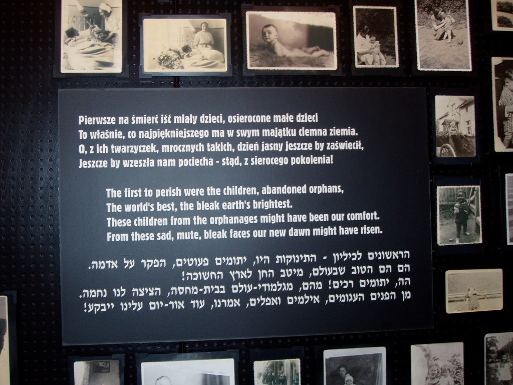 """""""The first to perish were the children"""" - pictures found among the remains of Auschwitz-Birkenau now displayed on a wall in the Auschwitz Museum"""